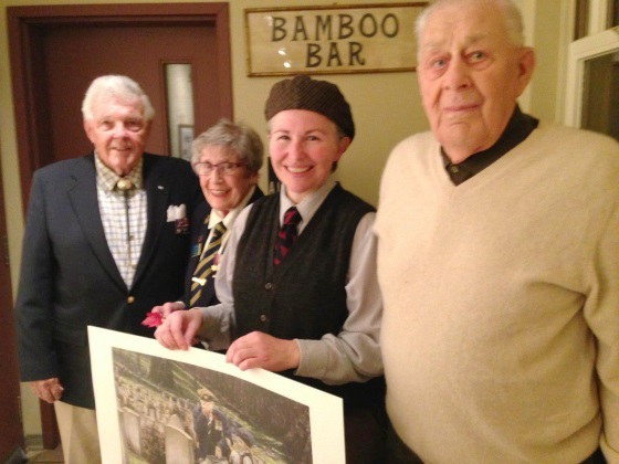 Julia Mackey presenting a print of the Fallen Hero to the Hudson Legion